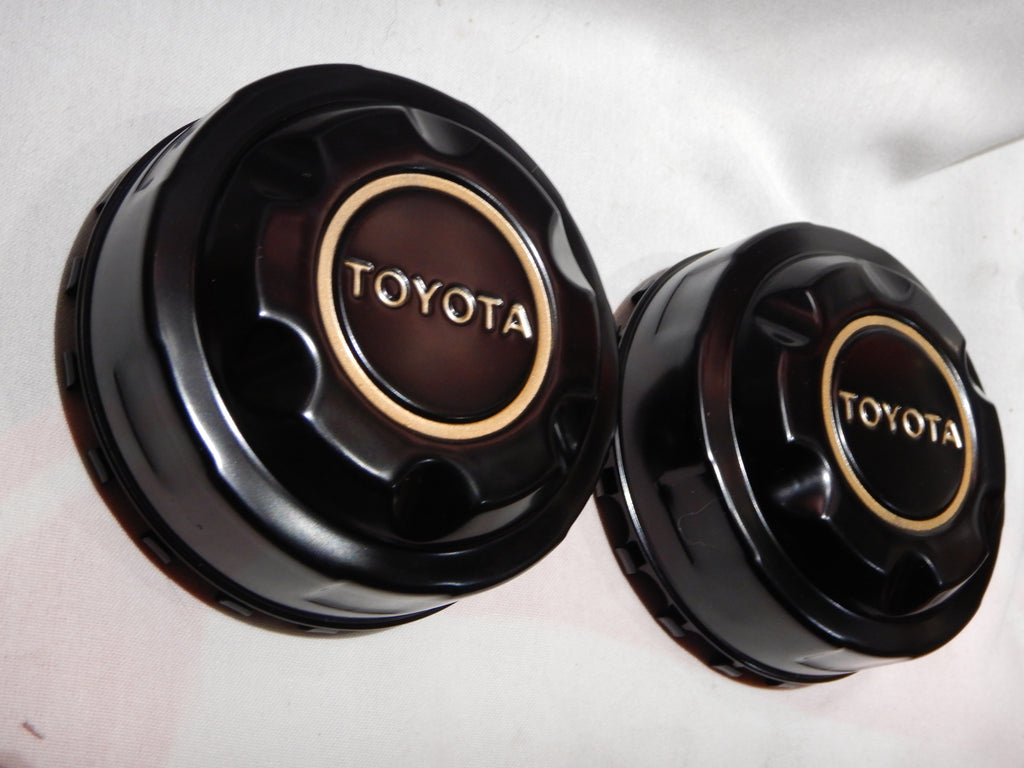 NEW Black OEM TOYOTA Center Cap Set FJ40 , FJ60 , FJ80 , hilux 4wd wagon wheels