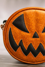 Load image into Gallery viewer, Half of a Small glitter orange scary smiling jack o lantern purse with orange stitching and black eyes and mouth
