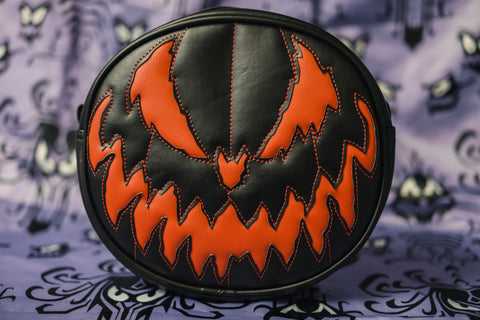 All black pumpkin handbag with matte orange pumpkin face.