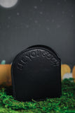"Back of black headstone wallet with ""see you soon"" embossed on the back."