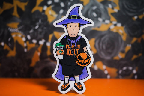 "Basic Witch kid sticker with ""pumpkin cult"" shirt, purple witch hat, purple cape, orange shoes,  pumpkin spice drink, and our signature pumpkin bag in orange and black."