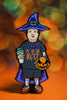 "Basic Witch kid pin with ""pumpkin cult"" shirt, purple witch hat, purple cape, orange shoes,  pumpkin spice drink, and our signature pumpkin bag in orange and black."