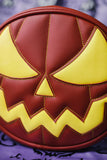 Mean Face Pumpkin bag is made with Wine and yellow vinyl with green stitching on purple background.