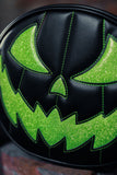All black pumpkin bag with scary face in sparkly lime green with green stitching.