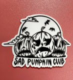 Close up of white and black sad pumpkin club with three pumpkins sticker.