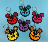 6 rubber spider web ear key chains on blue background.