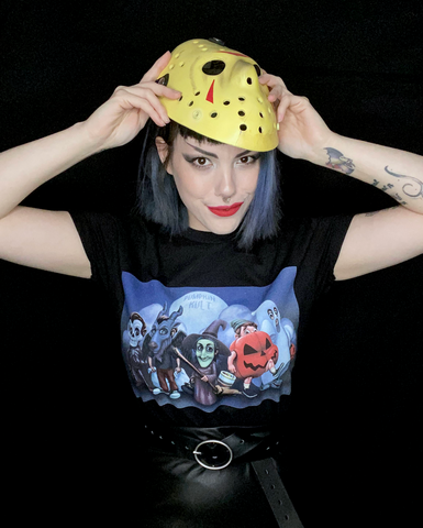 girl wearing pumpkin kult tricks over treats tee