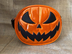 Orange jack o lantern pumpkin bag with orange stitching and a black scary smiling face