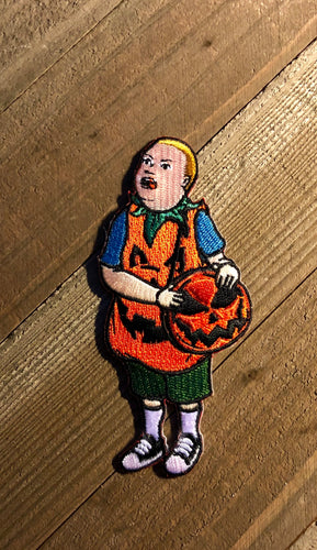 Boy with Pumpkin Costume and Pumpkin Purse patch on a wooden Background