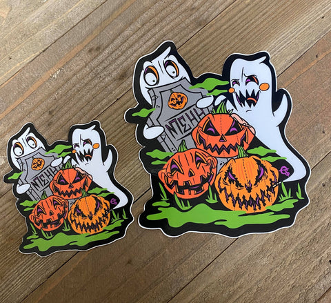 Vinyl sticker of ghosts in a graveyard with jack-o-lanterns.  Large and small.