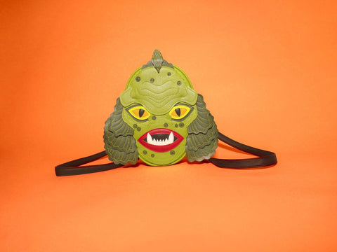 swamp monster backpack on orange background