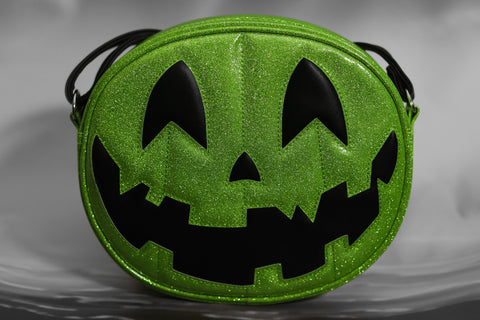 Pumpkin hand bag in sparkly green with a matte black happy pumpkin face.
