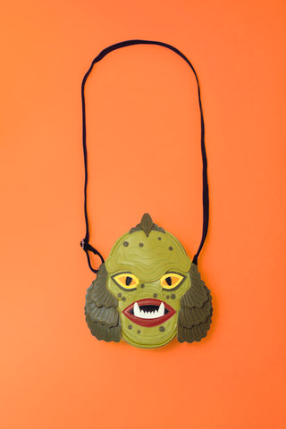 Swamp monster bag on orange background.