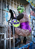 Girl dressed as monster wearing the monster bag, Glitter Purple and green glitter bag has black and white glitter pipping , green matching zipper