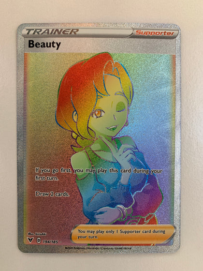 Beauty - 194/185 SWSH Vivid Voltage Rainbow Rare Trainer (M/NM)