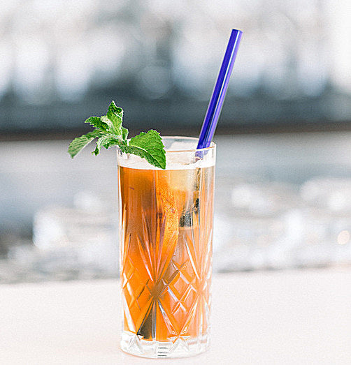 Photo of iced tea in tall glass with 9-inch glass straw by ToMA Glass Straws. Photo by Ammy & Hien Photo Co.