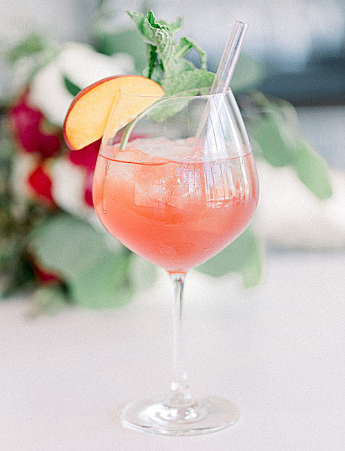 Photo of ToMA glass straw in peach cocktail by Ammy & Hien Photo Co.