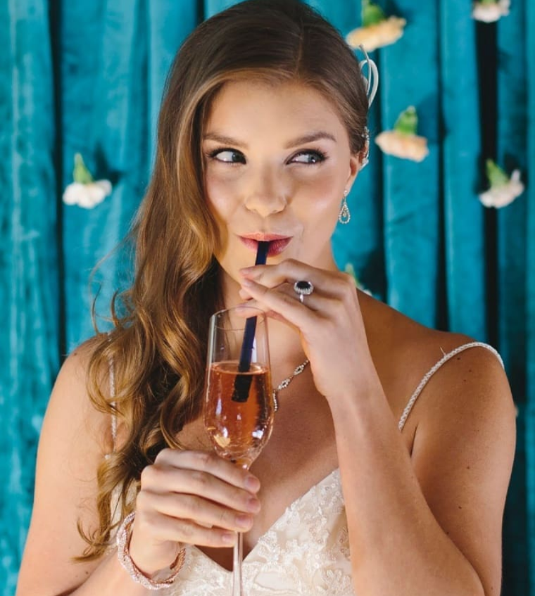 photo of bride sipping drink with ToMA glass straw in pacific blue. Photo by Emily Wenzel