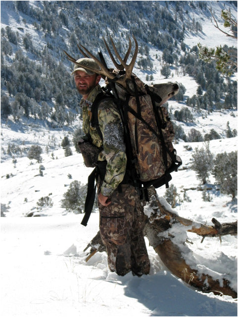 Kyle Packing out Mule Deer Buck