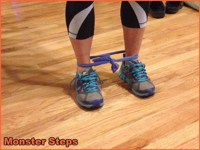 Using a resistance band take shoulder width side steps both directions