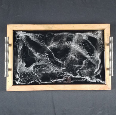 Black and metallic silver serving tray. Food safe resin art on a wooden base with metal handles. Impress guests with this one of a kind handmade functional art piece. Hang up when not in use for an elegant, classy, and unique decor.