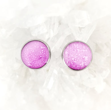 Elegant and glossy, these pretty pink studs have hints of white. They're a perfect addition to any outfit! The reflective resin finish adds a touch of class. They can easily be dressed up or dressed down. Guaranteed to be one of a kind! Stainless steel back and posts are hypoallergenic.  These 12mm studs are hand painted alcohol ink art, so an absolutely unique pair!