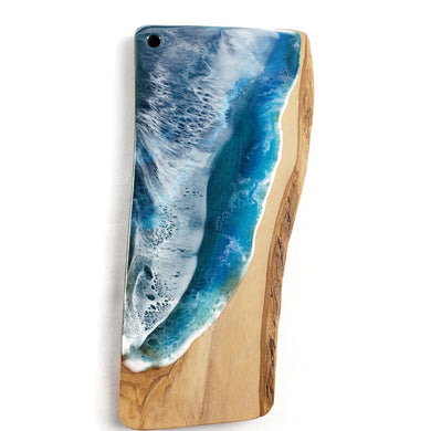 Charcuterie or cheese board, beach resin art with two waves. Functional art for your kitchen with these beautiful and unique homewares, guaranteed to be one of a kind. Food safe resin used, you can use as cutting board on back side. Hang as decor in your beach cottage or beach house, or anywhere there is ocean inspired decor or a calm soothing atmosphere!