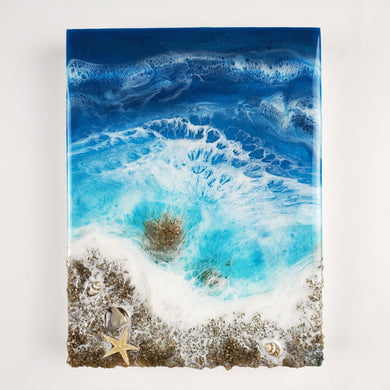 The turquoise and dark blue subtle shimmer of this ocean inspired resin art piece have such a calming vibe. With white lacing
