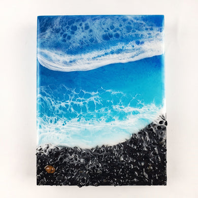 The turquoise and dark blue subtle shimmer of this ocean inspired resin art piece have such a calming vibe. With white lacing detail beautifully blended in the 2 layers of