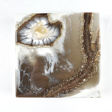 Load image into Gallery viewer, This geode inspired resin art piece was created white and brown with subtle touches of metallic gold, embellished with real Quartz cluster and Citrine chips, as well as metal flakes adding depth and interest. The translucent brown gives the illusion of floating white lacing details, and the cluster corner is made to emanate growth from within. Guaranteed to be unique, and it's hand made with lots of attention and positive intention.