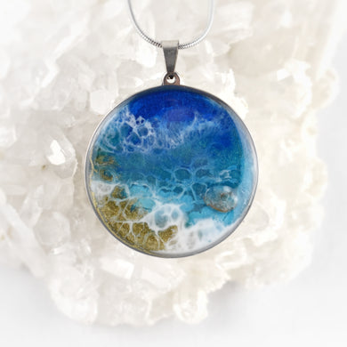 Beach inspired pendant, stainless steel base and adjustable chain, resin art with glittery detail and apatite stone.