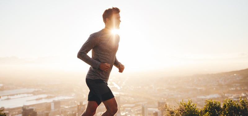 a man running in the hills training to become a personal trainer