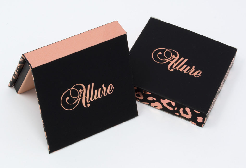 Single eyeshadow package with sleeve: black, pink, and rose gold leopard print.