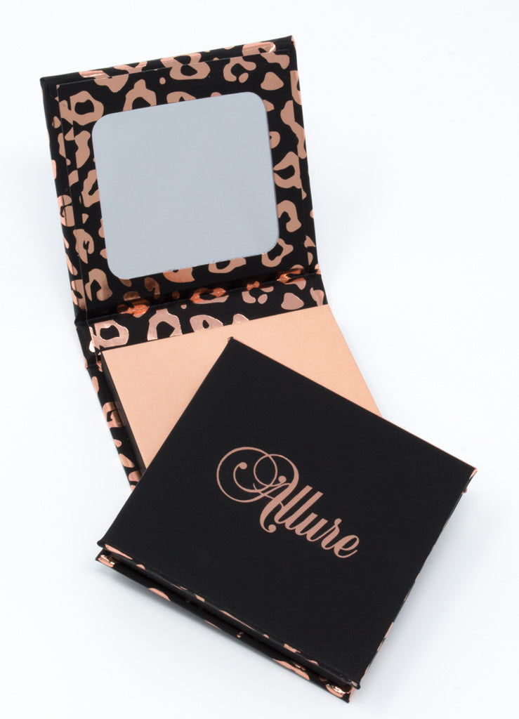 Single eyeshadow package and sleeve: black, pink, and rose gold leopard print. Mirror included.