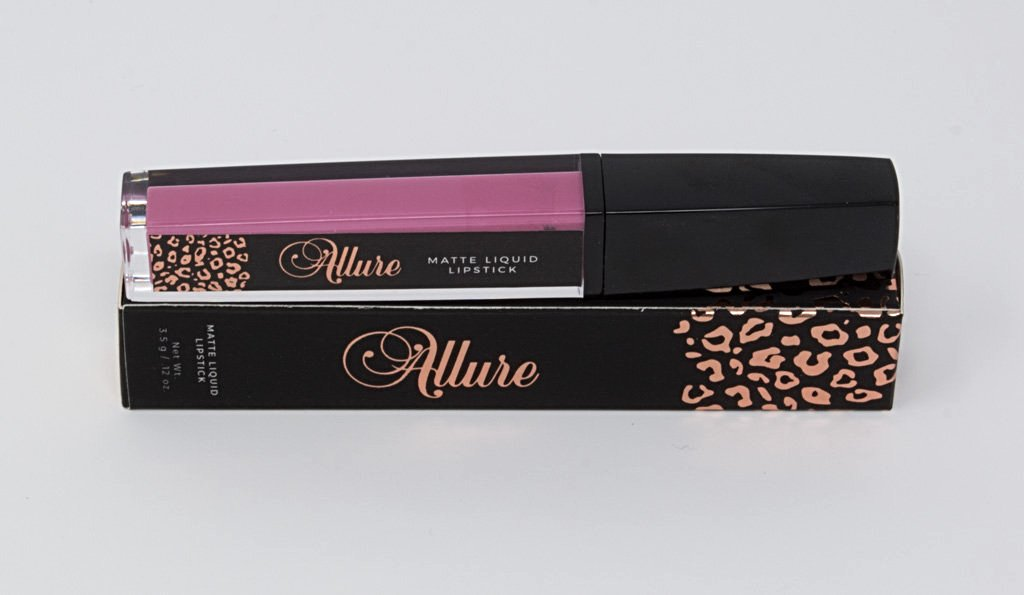 Matte liquid lipstick tube and sleeve: black, pink, and rose gold leopard print.