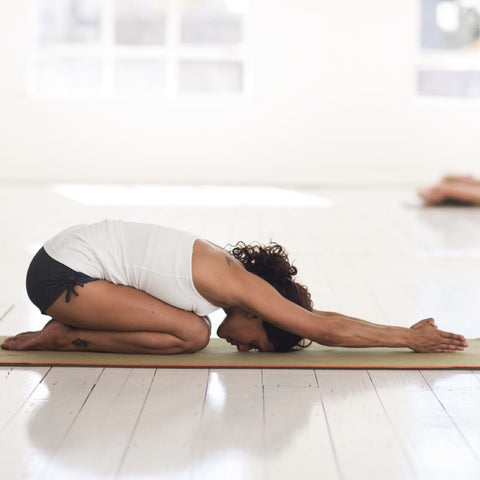 Yogini in Child's Pose