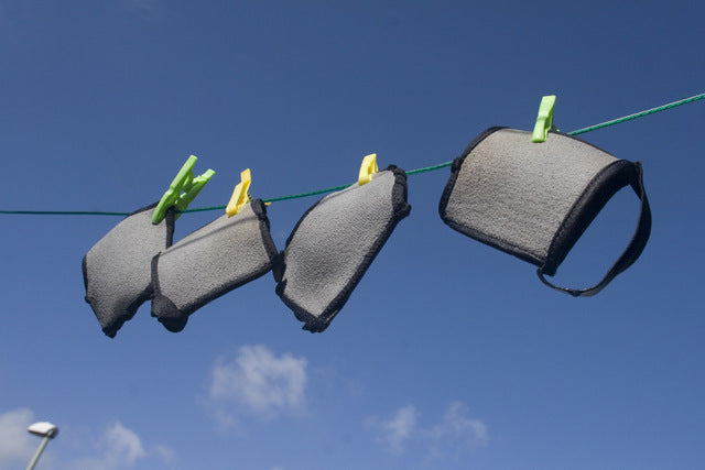 YogaPaws gloves and socks, hanging on a line.