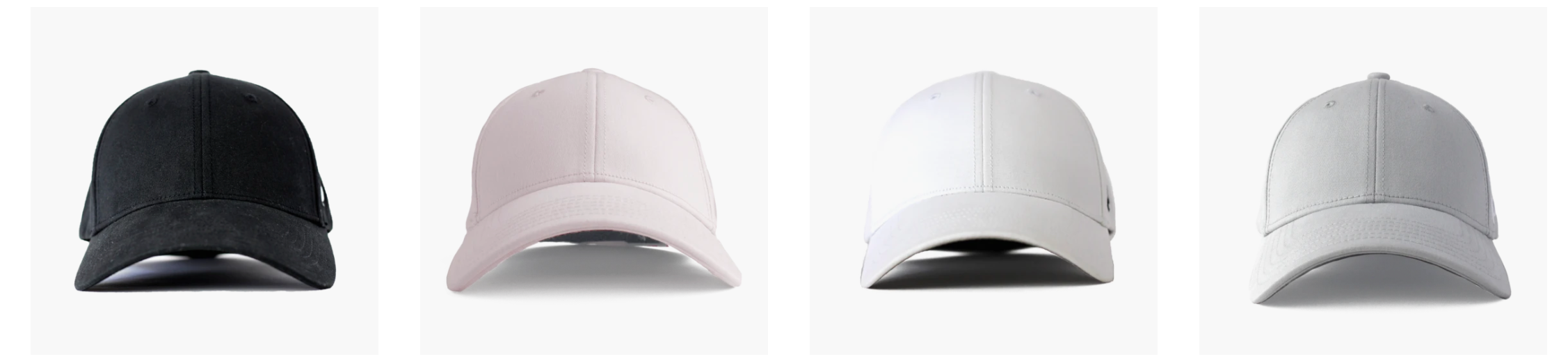picture of four hats in black, pink, white, and grey