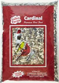Valley Farms Cardinal Mix Wild Bird Food product packaged in maroon with see thru window, bird images, contents are striped sunflower, black oil sunflower, Safflower seed, Buckwheat. Attracts Cardinals, Grosbeaks, Nuthatch, Pine Siskin, Sparrows, Woodpeckers