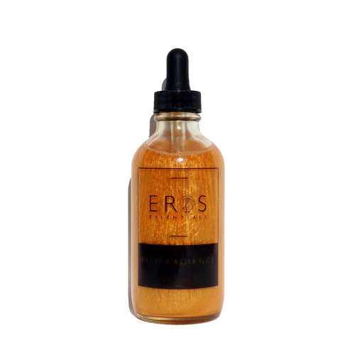 Gold Shimmering body oil in clear dropper bottle