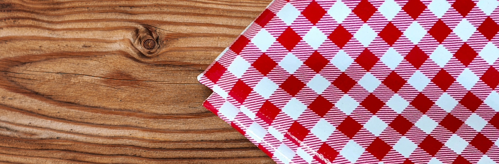 red and white gingham checks on a wooden board