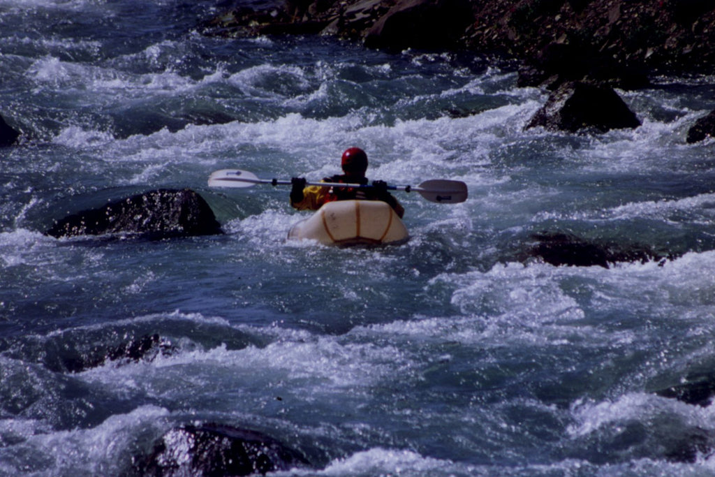 Thor Tingey testing the very first Alpacka Raft on the Aniakchak River, 2001