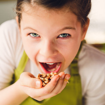 Girl Eating Activated Organic Nuts