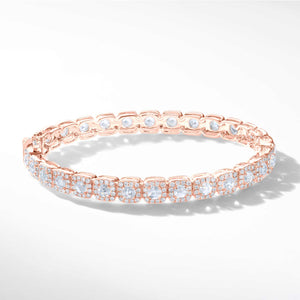 64Facets Cushion Diamond Bangle in 18K rose Gold. Rose Cut Diamonds are encircled i brilliant cut diamonds in a pave setting in a cushion shape.