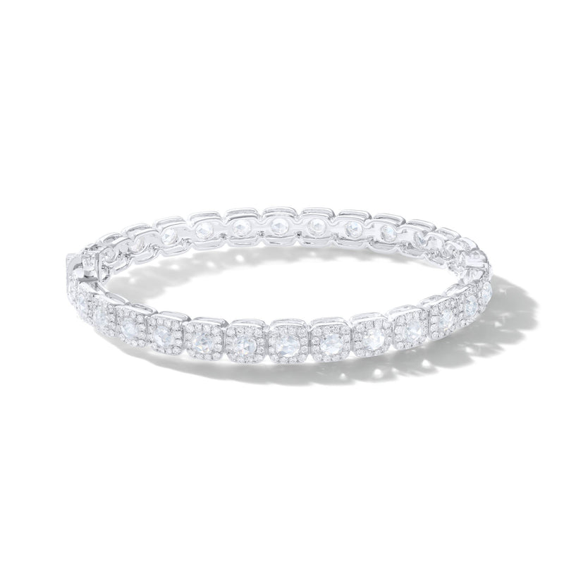 64Facets Cushion Diamond Bangle in 18K Yellow Gold. Rose Cut Diamonds are encircled i brilliant cut diamonds in a pave setting in a cushion shape.
