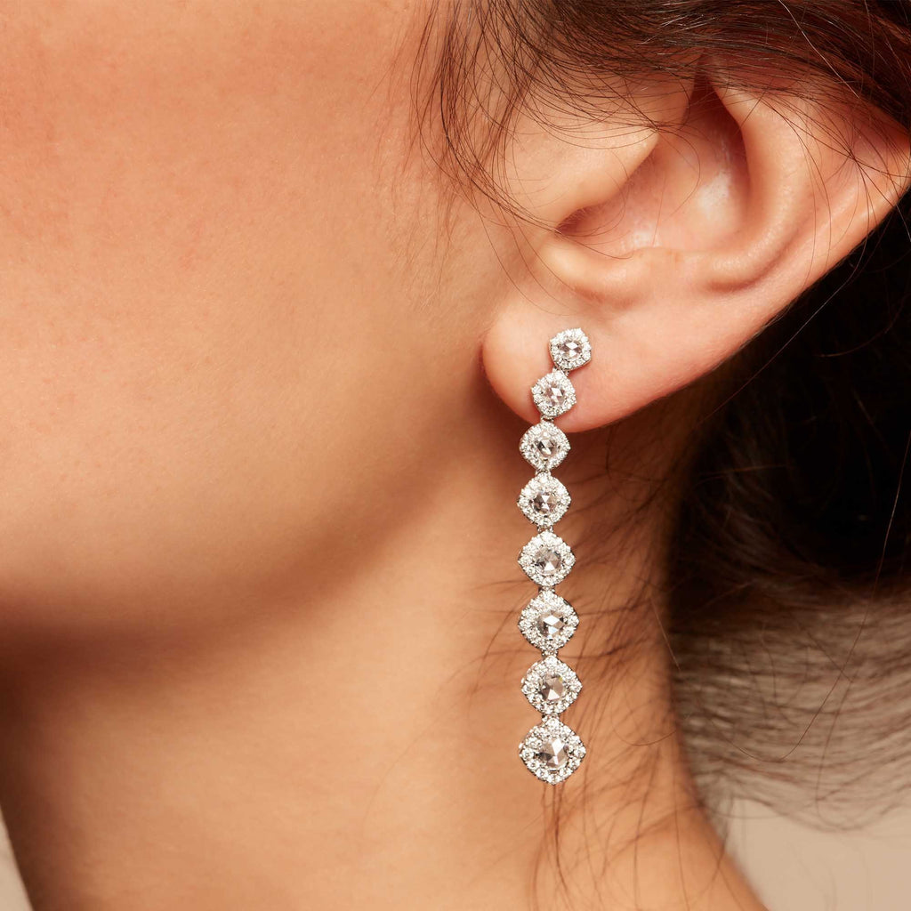 Diamond dangle earrings on model. Rose cut diamonds with brilliant cut diamonds in a micro pave setting.