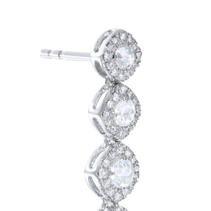 Diamond dangle earrings close up. Rose cut diamonds with brilliant cut diamonds in a micro pave setting.