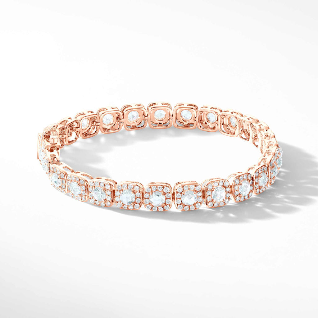 64Facets Diamond Tennis Bracelet. Rose Cut Diamonds are encircled by Pave Diamond Accents in a Cushion Motif. Set in 18K Rose Gold.