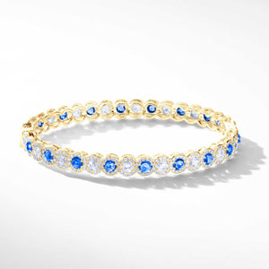 Elements gemstone and diamond bangle. Diamond bracelet with alternating rose-cut sapphires and diamonds.