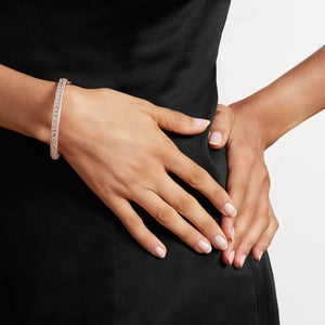 Linear Diamond Bangle - Round Shape. Available in White, Rose and Yellow Gold.
